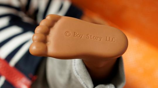 Boy Story LLC stamped on the left foot of each doll