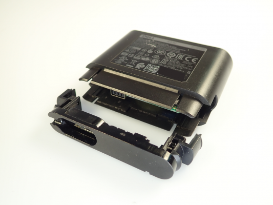 Detached casing of recalled Dell Hybrid Power Adapter sold with Dell Power Banks.