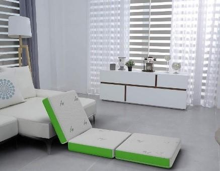 Recalled Cushy Form Tri-Fold Folding Mattress setup as extra seating.