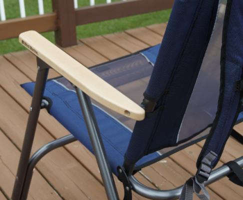 Wooden armrest on folding chair