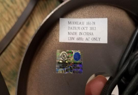 Label with model number and date code on chandelier's canopy