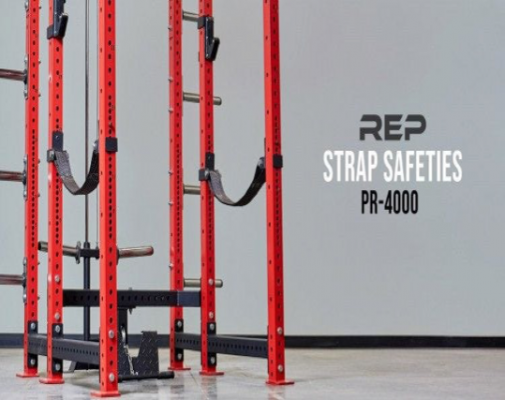 PR-4000 Strap Safety Brackets attached to the weight lifting posts of a squat stand