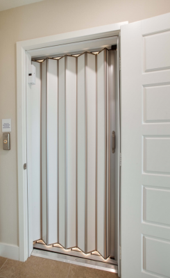 The door to the elevator generally matches all other doors in the home. The elevator gate may be open metal lattice or a solid folded sliding door.