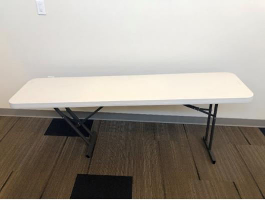 Recalled seminar table with over-rotated brace arm.