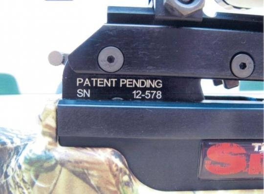 The unique serial number (12-XXX) is printed on the crossbow