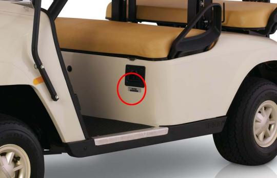 Serial numbers are printed on a plate or label inside the cab below the driver's seat.