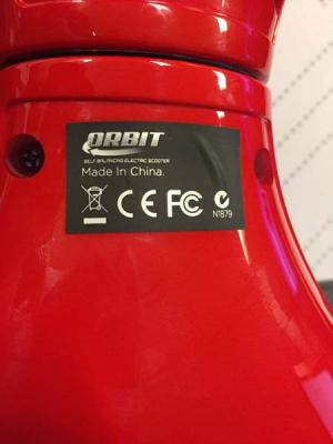 Orbit is printed on a black sticker on the underside of the hoverboards