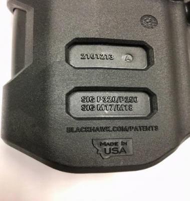 """Recalled gun holster marking """"2101213 A"""""""