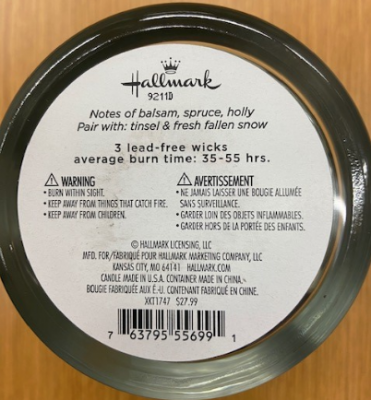 Date code 9211D, SKU code XKT1747 and UPC code 763795556991 appear on the candle's underside.