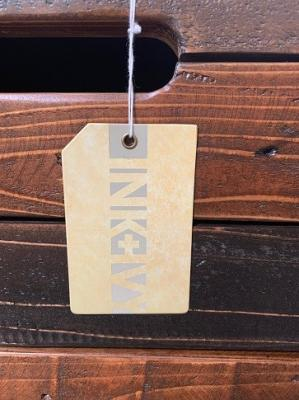 The INK+IVY brand is printed on a tag hanging from a dresser drawer