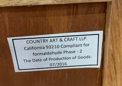 A Label on the back of the recalled Home Decorators Collection Print Block 4-Drawer Whitewash Chest lists the manufacturer and date of production.