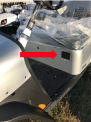 Red arrow marking the location of the serial number on the driver's side