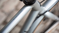 Model name is located on the top tube of the bicycle frame, behind the handlebars  and the stem.